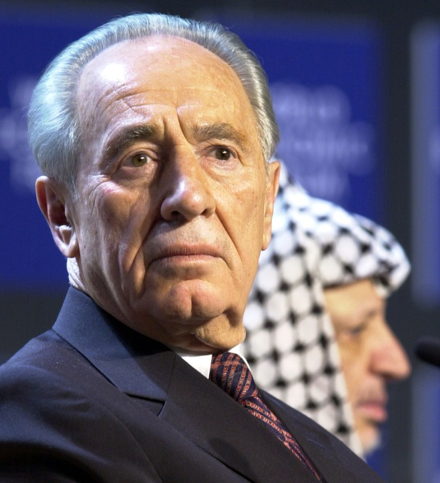 WEF: YASSER ARAFAT AND SHIMON PERES ATTEND A SESSION ENTITLED ' FROM PEACEMAKING TO PEACEBUILDING'